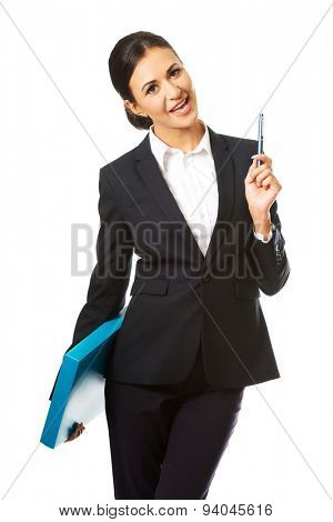Happy businesswoman holding a pen.