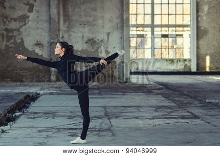 Young Modern Dancer Exercising In Abandoned Building
