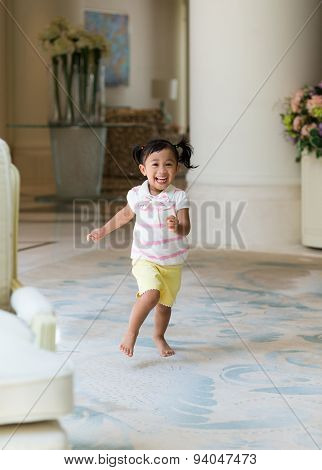 Excited girl playing at home