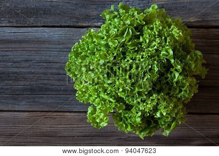 Salad lettuce natural organic vegetarian snack on vintage wooden background