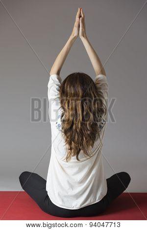 Woman Meditating, Rearview