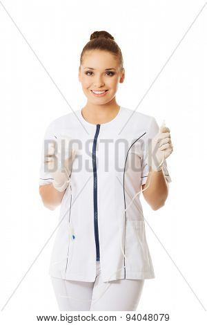 Female nurse holding a drip.
