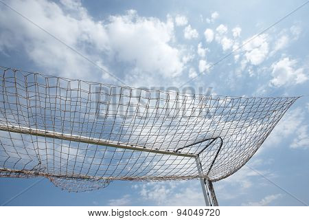 Packed Football Goal Net And Blue Sky