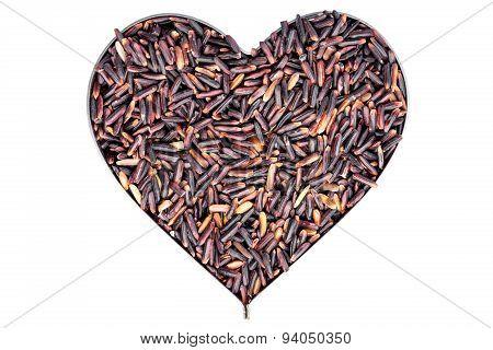Brown rice in heart steel block