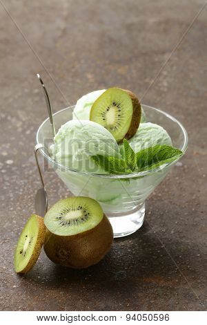 fruit creamy ice cream with green kiwi and mint