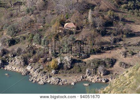 Little House Beside A Mountain Lake In Algeria