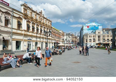 People Walking And Sitting On Benches On Kuznetsky Most Street
