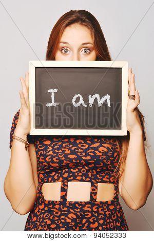 University College Student Holding A Chalkboard Saying I Am