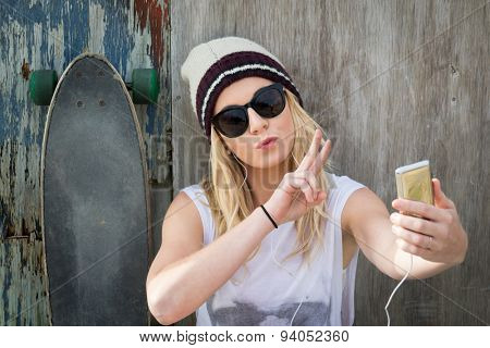 Cool skater girl taking selfie