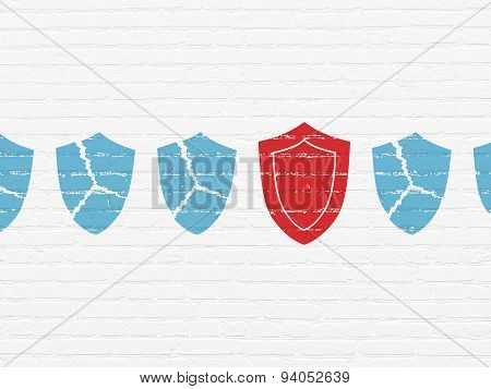 Protection concept: shield icon on wall background