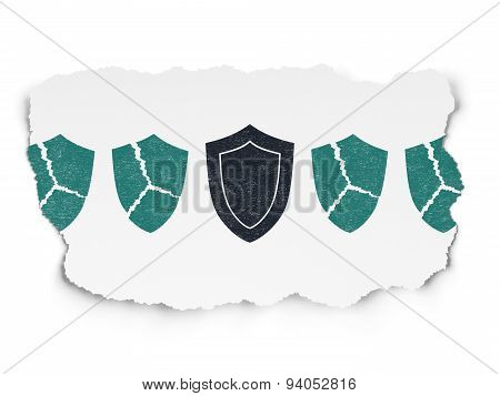 Privacy concept: shield icon on Torn Paper background