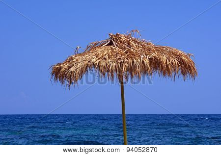 Beach umbrella by the sea