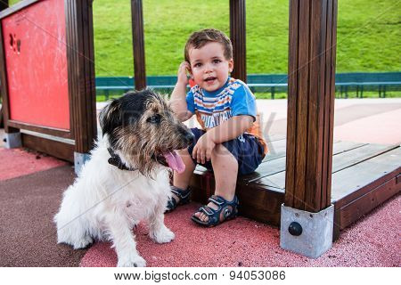 Baby With Little Dog On The Playground