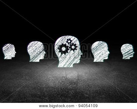 Finance concept: head with gears icon in grunge dark room