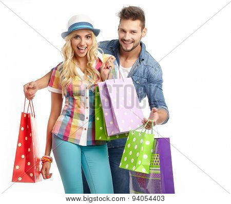 Young, smiling couple on a shopping spree. Shallow DOF, focus on woman's eye.
