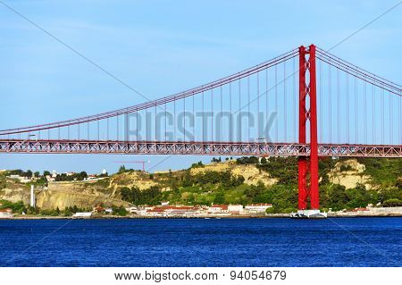 Red bridge over the Tagus river in Lisbon, Portugal.