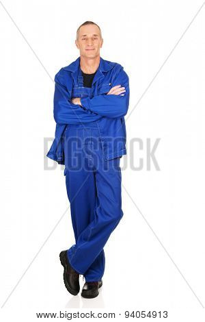 Smiling mature repairman with folded arms.