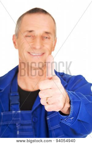 Portrait of repairman showing thumbs up.