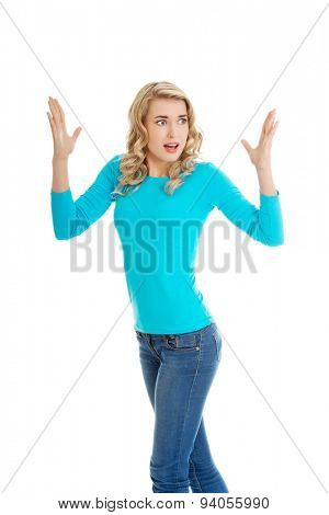 Angry woman with hands up.