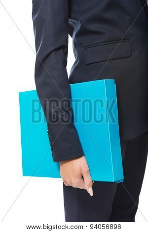 Close up on businesswoman holding her binder.