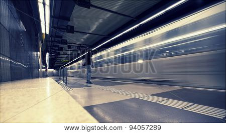 Subway station with passengers in motion blur
