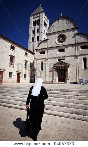 Nun going to church in Zadar, Croatia