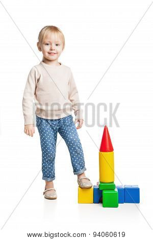 Baby girl building from toy blocks
