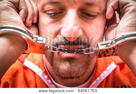 Sad Man With Handcuffs In Prison