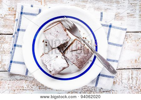Three Pieces Of Homemade Chocolate Brownie Dessert On A Plate