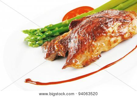 roast beef meat served with asparagus on white