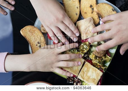 Children Hands With Sweets