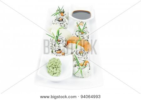 Maki Roll with Deep Fried Vegetables inside . on long white plate . isolated over white background . Japanese Cuisine