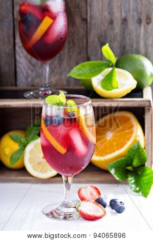 Ice cold red sangria with citrus fruits
