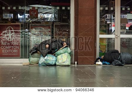 Homeless Woman Sleeping On The Bags And Envelopes