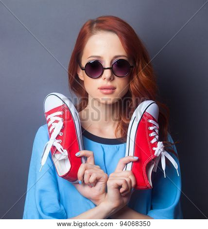 Girl In Blue Dress With Red Gumshoes