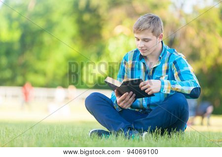 Young Teen Boy With Notebook