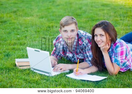 Young Teen Couple With Laptop Computer