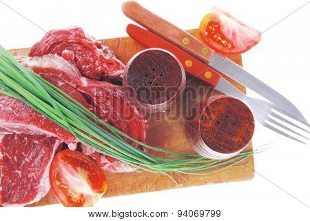 meat portion: bloody beef fillet on plate with cutlery served before cooking