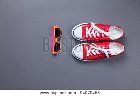 Red Gumshoes And Glasses