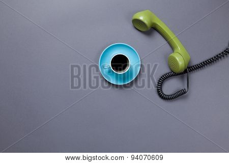 Coffee Cup And Retro Dial Phone