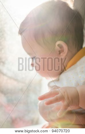 Portrait Of Cute Caucasian Little Baby Girl In Backlight