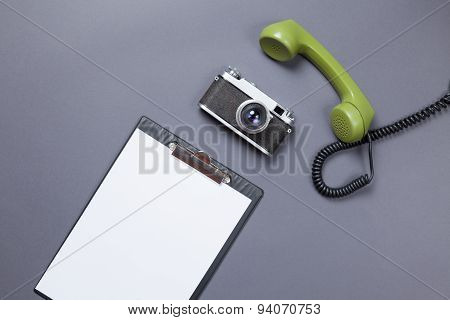 Business Board And Green Handset With Retro Camera