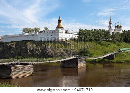 Bridge on the River Tour and Verkhotursky Kremlin with Trinity Cathedral. Verkhoturye.