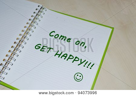 Come on get happy message on  open book