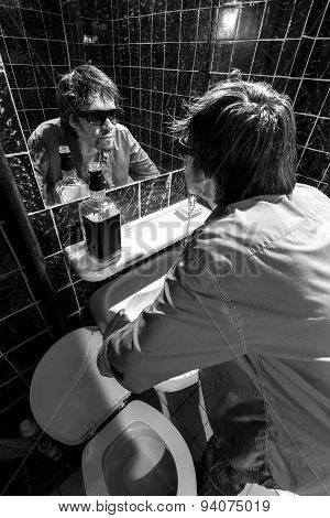 Drunk Man Looks At Himself In The Mirror