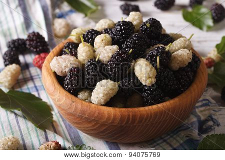 Fresh White And Black Mulberries In A Wooden Bowl