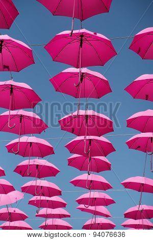 Many Decorative Pink Umbrellas