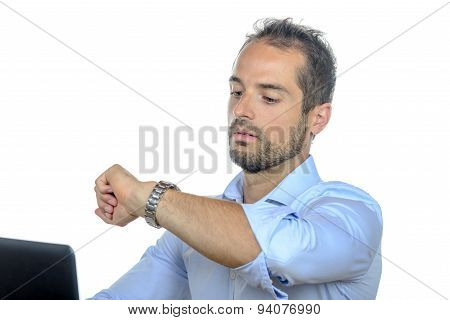 A Young Businessman Looking At His Watch