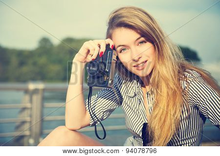 Beautiful Hipster Girl with Photo Camera