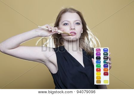 Woman With Paint And Brush